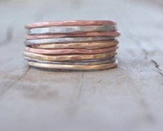 NINE ULTRA THIN stacking skinny rings in BRUSHED, Rustic FINISH. These babies…
