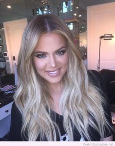 Khloe Kardashian long blonde curls