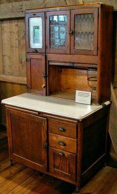 Rustic hoosier cabinet. Looks like great mini bar for man cave.