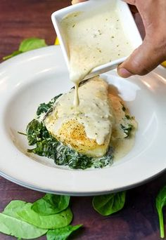 Foil Baked Chilean Sea Bass with Lemon Parmesan Cream SauceBaking this delicious dish sealed in foil along with garlic cream spinach adds additional flavor while it steams the fish to perfection. The lemon sauce blended with Parmesan cheese and whipp Seafood Dishes, Seafood Recipes, Cooking Recipes, Healthy Recipes, Halibut Recipes, Cooking Games, Fish And Seafood, Swordfish Recipes, Seafood Platter