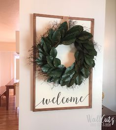 DIY farmhouse welcome sign! I used an old dry erase board / stained + painted it / stencilled on the word welcome and hung a wreath using burlap ribbon.