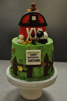 barnyard cake...I love the piped icing flowers growing up through the fence!