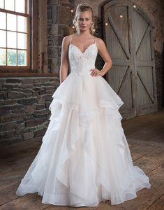Sweetheart Gowns 1123 Sand/Ivory Size 16 A dress to dream about. V-neckline with spaghetti straps that crisscross in the back and lead to the lightly beaded lace applique bodice. The ball gown skirt is created with layers of tulle and organza to the horsehair hem to ensure that all eyes will be on you. https://www.sweetheartgowns.com/sweetheart/1123