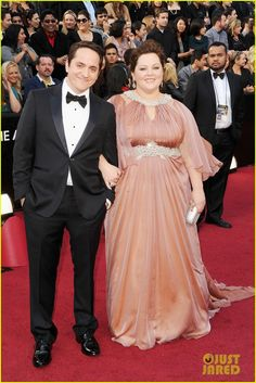 I'm very afraid for Melissa McCarthy at the 2014 Oscars. Witness, for instance, her 2012 Oscars gown. Forget the color, which does NOTHING for her, and let's focus on what's happening above the waist. She is not a theatre proscenium. You can just hear the designer (Marina Rinaldi)'s thought process, as feels the need to accentuate Melissa's waist with her bedazzling gun, and then also, draw eyes to her face through the necklace halter situation. Her beautiful bosoms look like Mrs…