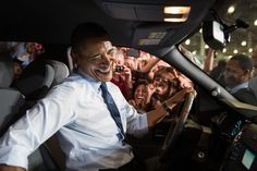 President Barack Obama greets Ford employees from the driver's seat of a Ford truck after delivering remarks on the economy at the Ford Kansas..