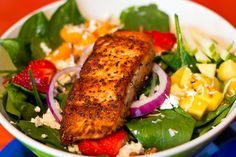 Citrus Mahi-Mahi Spinach Salad  A fresh fillet of Mahi-Mahi broiled with a citrus reduction served over spinach with diced tomatoes, cucumber, marinated red onion, toasted almonds and feta cheese, tossed with a citrus mango vinaigrette.  #bigbillysburgerjoint