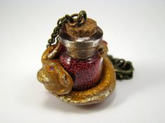 Polimer clays dragon pendant with glass bottle. See more at https://www.etsy.com/it/shop/NonninaSophieCrafts