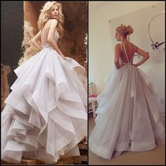 Hayley Paige ball gown wedding dress with crystal straps, strappy open back, natural waist, and organza ball gown skirt.