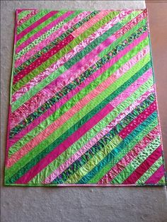 1600 on poimt  for a baby quilt.  layer your backing and batting.  draw a diagonal line on the batting and begin adding strips.  great idea!  I will try this!! MM