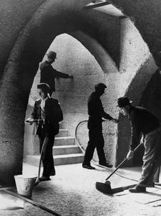 Unknown Photographer - Man at work in the south crypt of Guildford Cathedral, Surrey, England. May 13th, 1938. S)