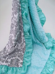 Soft pool green, this minky dot and gray damask blanket is a beautiful choice, and can be gender neutral. Machine was warm, tumble dry. Choose