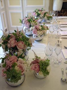 Rose and garden flowers in silver mirrored fish bowls