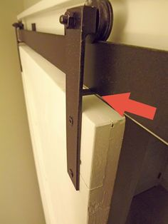 Make your own barn-door hardware.  Good instructions