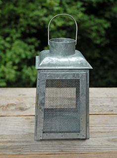 7.99 SALE PRICE! Fashion a rustic centerpiece out of this Galvanized Metal lantern. Place a votive candle inside this cage and surround it with shells, drift...