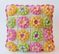 Blooming garden pillow by Dada's place. Based on the lily pad hexagon pattern by P.S. I crochet. Links to pattern in post.