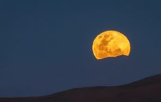 In this spectacular image the moon is rising above the mountains surrounding the Paranal Observatory.   Credit:  G. Brammer - September 25, 2014 - Cerro Paranal, Chile