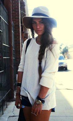 Baggy quarter sleeve white shirt, denim short shorts, hat.