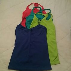 Bebe tank tops Bundle of 4 tank tops. 3 are cross back, 1 blue strappy Cami. If you know Bebe you know about these tanks. They are amazing and hold you in. Sizes are mixed with m/l and p/s. bebe Tops Tank Tops