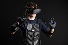 Lucian Copeland, co-founder of the University of Rochester student group NullSpace VR, models the Mark IIB prototype of their virtual reality suit. Ar Augmented Reality, Virtual Reality Headset, University Of Rochester, Tech Art, School Of Engineering, Vr Headset, Medical Technology, Wearable Technology, Future Tech