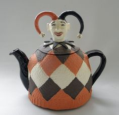 Paul Rayner (), New Zealander / Jester teapot .... jester or fool's head as lid on argyle or harlequin pattern body, in rust, cream and black, c. 2010s, ceramic, Wanganui, New Zealand