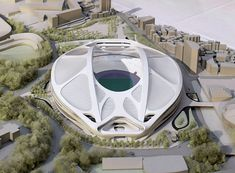 "Photo shows a model of the planned 2020 Tokyo Olympics stadium displayed at a Japan Sports Council meeting on July 7, 2015. Prime Minister Shinzo Abe said July 17 that Japan will review a construction plan for the stadium ""from scratch"" in response to mounting public criticism over its soaring costs. (Kyodo) ==Kyodo"