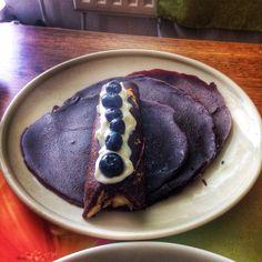 Chocolate pancakes with pranut butter, banana, greek yogurt and blueberries