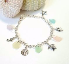 GENUINE Beach Glass Bracelet With Charms - Turtle, Sand Dollar, Sea Horse and Starfish in all Sterling Silver! Pretty sea life and pastel sea glass/beach glass bracelet in all Sterling Silver! Unique