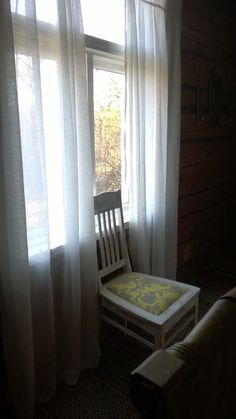 Cottage interior. 1940's chair. Amy Butler pattern. Window and linen curtains.