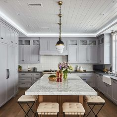 Gray Kitchen Cabinets With Black Marble Countertops