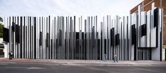 Mercado de Getafe by A-cero. A façade with protruding lighting has been added to this building in Spain