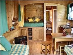 wonderful tiny house layout, very traditional.......finally a bed without the loft......I don't want to be climbing stairs and crawling to change the sheets by brookeO