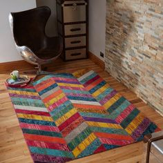 Fun and bright with a playful twist, Prismatic Cyan Multi Designer Rug showcases a traditional design. With a beautifully, vibrant, blended colours it offers a 'vintage style' appearance. #multicolouredrugs #stylishrugs #traditionalrugs #rugsonsale #rugsale