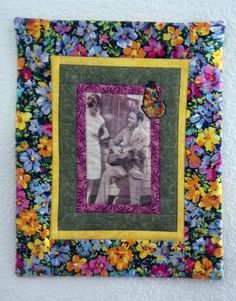 This is the type of quilt I want to learn how to make. I think photos inside of quilts are really cool and different.