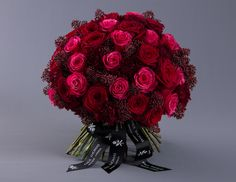 Jewel: A stunning combination of hot pink roses, lush ruby red roses and deep rich garnet carnations arranged amongst a filigree of crimson skimmia flowers, creating a dazzling, extravagant bouquet. From £155.00 (12 roses) From Paul Thomas Flowers, http://www.paulthomasflowers.co.uk/. We offer same day local delivery and next day national UK delivery on all orders.