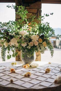 Centerpiece, Flowers by: Honey of a Thousand Flowers, Photo: Docuvitae - Wyoming Wedding http://caratsandcake.com/yubetehanddennis