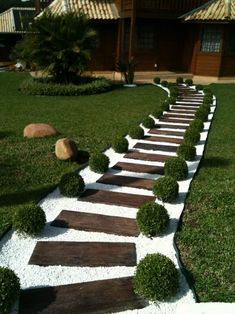 31 Great Front Walkway Ideas You Will Want To Implement Now!- 31 Great Front Walkway Ideas You Will Want To Implement Now! for 2019 – A Nest With A Yard Grass and shrubs create the perfect border to a walkway made of pallet wood and white pebbles - Small Front Yard Landscaping, Garden Landscaping, Backyard Walkway, Front Yard Walkway, Simple Landscaping Ideas, Backyard Ideas, Wooded Backyard Landscape, Railroad Ties Landscaping, Sidewalk Landscaping