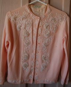 50s Vintage pink sweater I would eat it open with a cute lacey camisole underneath.  Wear with jeans and cute boots or shoes.