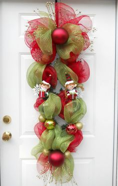 Items similar to Custom Deco Mesh Christmas Easter Wreath Swag Decoration in Your Choice of Colors Pre-Order for 2014 on Etsy Mesh Christmas Tree, Green Christmas, Christmas Candy, Elf Decorations, Christmas Decorations, Christmas Projects, Holiday Crafts, Theme Noel, Wreath Crafts
