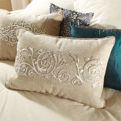 Paragon, defined as a model of excellence, perfectly describes this elegant collection. Our shimmer pillows are Handcrafted with Swarovski crystals, rhinestones and metal embellishments, encrusting the entire front of the pillow. The metalwork on linen styles are done in an embroidery technique called Zardozi which requires the use of metal threads. This opulent collection will add that small touch of glam you have been looking for!