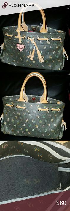 Dooney & Bourke purse Great Union Burke purse Wellman team there's a small Corner if you see at the picture with a little fade on each corner but very little not very noticeable Dooney & Bourke Bags