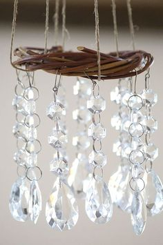 I'm thinking I can make these for my garden with some little dollar store grapevine wreaths, string, and a bag of inexpensive broken jewelry from the thrift store. Or crystals from an old chandelier. Mobiles, Carillons Diy, Diy Wind Chimes, Crystal Wind Chimes, Wind Spinners, Diy Schmuck, Diy Garden Decor, Suncatchers, Grapevine Wreath