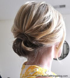 Easy updo, not sure it would be so easy for me...i've got 2 left hands when it comes to teasing, pinning, styling...