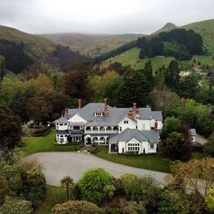 The stately Otahuna Lodge sits in a picturesque valley on New Zealand's South Island. Photo courtesy of eahoneymoons on Instagram.