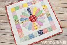 "Out of the Great Depression came this fantastic <a href=""http://www.favequilts.com/tag/Vintage"" target=""_blank"">vintage pattern</a>: the 1930s Dresden Plate Mini Quilt. Made with a bundle of prints inspired by the '30s, you'll need a bunch of 2.5 inch squares, some background fabric, dresden blades, and fabric for binding. You can download the tutorial and template to make this quilt pattern in ..."