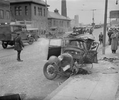Car stolen by kids crashes into lawyer's car, Boston, 1935.
