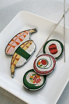 """sushi cloisonne enamel brooches. Sue Szabo. from the series """"almost good enough to eat"""". these are vitreous cloisonne enamel brooches in various sushi forms."""