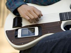 """The gizmo comprises of an electronic guitar that can be embedded with an iPhone on which you can download an app that will illuminate the fret board and let the player """"see"""" the chords that he wants to play. With three learning levels-easy, medium and difficult- the gTar promises to help hasten up the process of learning how to play the guitar."""