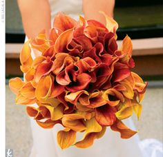 All the bouquets were made of a single flower: orange flame calla lilies. Kelly's cluster of blooms was tied with black satin ribbon.