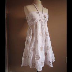 White and Gold Beach Cover Up Dress Never worn white with gold emblem print dress.  Lined Dress, with tie back. New and Never worn, no tags. Tags says M, but runs small. Swim Coverups