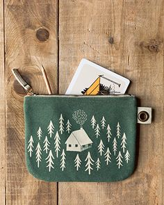 Retreat Large Zipper Pouch - A large zipper pouch made from sturdy 100% cotton is perfect for storing drawing supplies, small accessories, travel essentials and more. A metallic zipper keeps contents secure, while a grommet tab adds convenience. A cozy cabin in a forest clearing invites you inside to warm by a crackling fire. Cozy Cabin, Travel Essentials, Zipper Pouch, Contents, Invites, Metallic, Fire, Drawing, Studio
